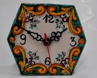 Orologio esagonale I° misura decori assortiti diametro cm.12 €19,50